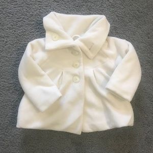 White fleece jacket with button closure